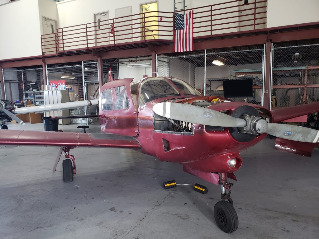 Red Piper Turbo Arrow undergoing maintenance